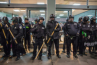 NEW YORK, NY - JANUARY 28: Police protect the entrance of the airport during a demonstration against the Muslim immigration ban at John F. Kennedy International Airport on January 28, 2017 in New York City. President Trump signed an executive order to suspend refugee arrivals and people with valid visa from Iran, Iraq, Libya, Somalia, Sudan, Syria and Yemen. Photo by VIEWpress/Maite H. Mateo.