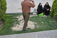 Iranian tourist enjoy the park at Imam Square. Imam Square or Naqsh-E Jahan, is a square situated at the center of Isfahan city, Iran. Constructed between 1598 and 1629, it is an important historical site, and one of UNESCO's World Heritage Sites in Iran. It is 160 meters wide by 508 meters long. The square is surrounded by buildings from the Safavid era. The Shah Mosque is situated on the south side of this square. On the west side is the Ali Qapu Palace. Sheikh Lotf Allah Mosque is situated on the eastern side of this square and the northern side opens into the Isfahan Grand Bazaar.
