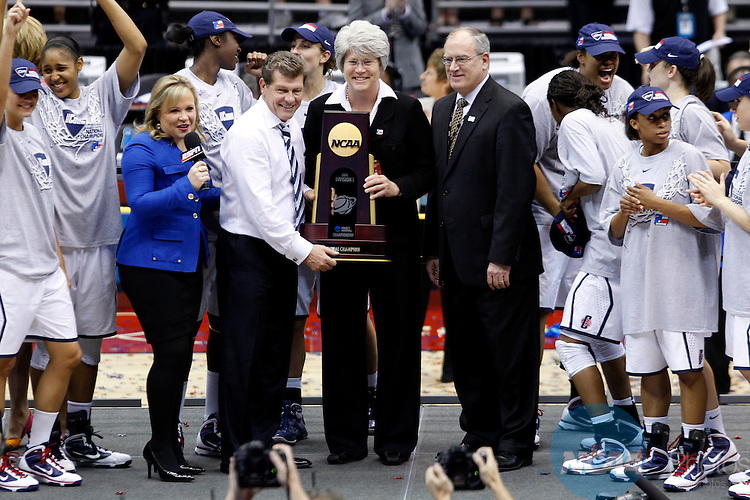 06 APR 2010:  University of Connecticut Women's Basketball Head Coach Geno Auriemma (left) accepts the National Championship trophy after the Huskies defeated Standford University in the Division I Women's Basketball Championship held at the Alamodome in San Antonio, TX.  Connecticut defeated Stanford by a score of 53-47 to take home their second straight National Championship.  Trevor Brown, Jr. /NCAA Photos