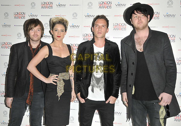 Katie Waissel & guests.The London Lifestyle Awards 2011, Park Plaza Riverbank hotel, Albert Embankment, London, England..October 6th, 2011.half length black dress leopard print waistband jacket grey gray hat white.CAP/CAN.©Can Nguyen/Capital Pictures.