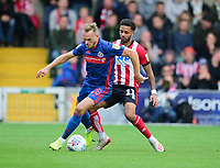 Lincoln City's Bruno Andrade vies for possession with Sunderland's Laurens De Bock<br /> <br /> Photographer Andrew Vaughan/CameraSport<br /> <br /> The EFL Sky Bet League One - Lincoln City v Sunderland - Saturday 5th October 2019 - Sincil Bank - Lincoln<br /> <br /> World Copyright © 2019 CameraSport. All rights reserved. 43 Linden Ave. Countesthorpe. Leicester. England. LE8 5PG - Tel: +44 (0) 116 277 4147 - admin@camerasport.com - www.camerasport.com