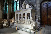 Tomb of  Louis XII (1462 - 1515) King of France 1498 to 1515 and his wife Anne of Bretagne who was alos wife of Charles VIII in 1491. The four sculptures at the corners of the monument represent prudence, justice, force and temperance abd the Bas relief along the bottom of the monument shows scenes from the wars against Italy. The Gothic Cathedral Basilica of Saint Denis ( Basilique Saint-Denis ) Paris, France. A UNESCO World Heritage Site.