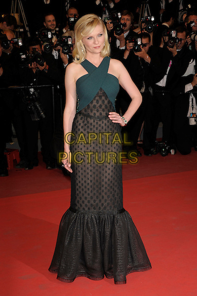 KIRSTEN DUNST.'Melancholia' premiere at the Palais des Festivals, 64th International Cannes Film Festival, France.18th May 2011..full length black dress fishtail long maxi hand on hip   print patterned green  grey gray top .CAP/PL.©Phil Loftus/Capital Pictures.