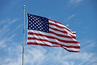 Photo of American flag waving in the wind on a breezy day in Austin, Texas, USA
