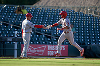 Clearwater Threshers manager Marty Malloy (2) congratulates Matt Kroon (45) after hitting a home run during a Florida State League game against the Palm Beach Cardinals on August 10, 2019 at Roger Dean Chevrolet Stadium in Jupiter, Florida.  Clearwater defeated Palm Beach 11-4.  (Mike Janes/Four Seam Images)