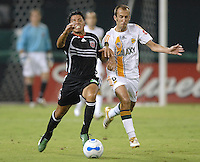 DC United's Christian Gomez (10) fights for the ball and is being covered by Los Angeles Galaxy's Peter Vagenas (8). Los Angeles Galaxy defeated DC United 5-2, Saturday, August 26, 2006 at RFK Stadium.