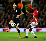 Dmytro Hrechyshkin of FC Zorya Luhansk and Marcus Rashford of Manchester United during the UEFA Europa League match at Old Trafford Stadium, Manchester. Picture date: September 29th, 2016. Pic Matt McNulty/Sportimage