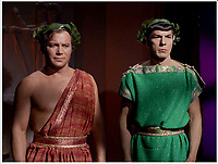 BNPS.co.uk (01202 558833)<br /> Pic: NBC/Paramount/PropStore<br /> <br /> Captain Kirk and Mr Spock..<br /> <br /> Historic Star Trek toga in which Capt Kirk boldy went where no US TV series had gone before...<br /> <br /> The toga Captain Kirk wore while locking lips with Lieutenant Uhura in one of the first inter-racial kisses on television 50 years ago has emerged for sale for &pound;46,000 ($60,000)<br /> <br /> William Shatner was dressed in the maroon Grecian toga for the tender moment with Nichelle Nichols in the episode 'Plato's Stepchildren' filmed in 1968.<br /> <br /> The toga will go under the hammer alongside Mr Spock's green toga worn by Leonard Nimroy in the same episode, which is valued at &pound;23,000.