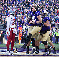 Jacob Eason is fired up after he scores the Huskies' first touchdown of the game.