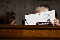 Senator Roger Wicker, Republican of Mississippi, talks with an aide during a Senate Commerce Committee hearing on Capitol Hill in Washington, DC on February 6, 2019. Photo Credit: Alex Edelman/CNP/AdMedia