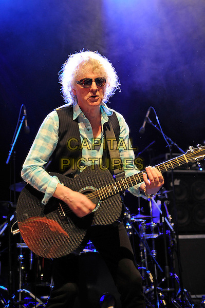 Ian Hunter .performing live in concert, Shepherd's Bush Empire, London, England, UK, .19th October 2012..half length music concert gig live on stage sunglasses playing guitar sunglasses waistcoat blue shirt checked .CAP/MAR.© Martin Harris/Capital Pictures.
