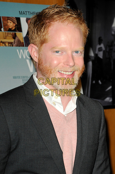"JESSE TYLER FERGUSON .arriving at the premiere of ""Wonderful World"" at the DGA Theatre in Los Angeles, California, USA, .January 7th 2010..portrait headshot beard facial hair smiling pink sweater jumper v-neck white shirt grey gray .CAP/ROT.©Lee Roth/Capital Pictures"
