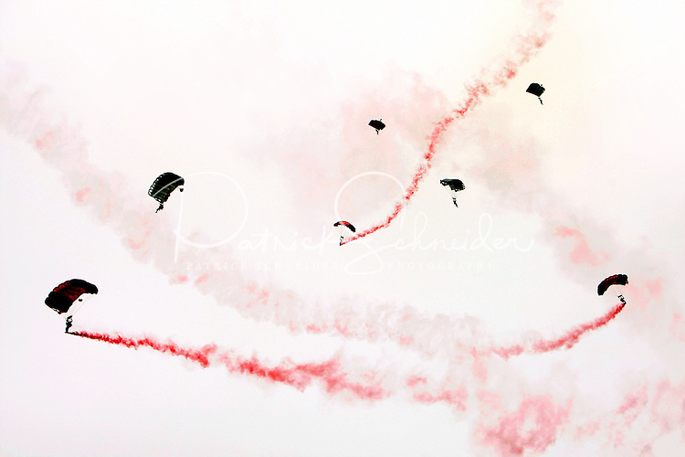 Paratroopers float from the sky during opening ceremonies for the Coca-Cola Classic 900 NASCAR Race at the Lowe's Motor Speedway, in Concord, NC, held on Memorial Day 2009 (the race was delayed a day because of rain). Driver David Reutimann won his first Cup race during the rain-shortened event, held May 25, 2009. NASCAR's longest scheduled race went only 227 laps, or 340.5 miles, before officials ended it because of rain. The 2009 race was the 50th running of the Coca-Cola 600. Ryan Newman and Robby Gordon finished second and third respectively.