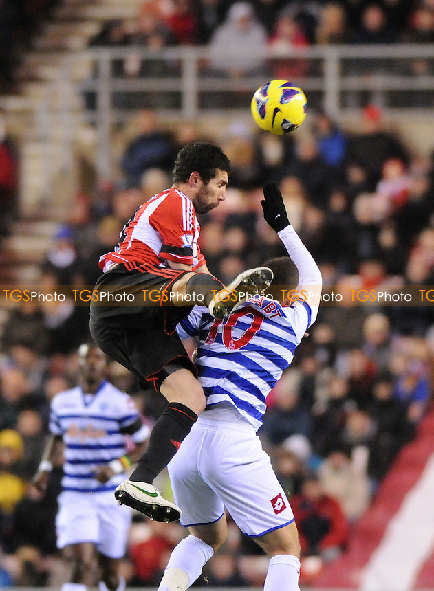Sunderland's Carlos Cuéllar battles with Queens Park Rangers's Adel Taarabt - Sunderland vs QPR - Barclays Premier League Football at The Stadium of Light, Sunderland, Tyne & Wear - 27/11/12 - MANDATORY CREDIT: Steven White/TGSPHOTO - Self billing applies where appropriate - 0845 094 6026 - contact@tgsphoto.co.uk - NO UNPAID USE.