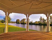 Looking south through gazebo in park on Willamette River. Harrisburg, Oregon