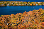 Fall foliage surrounds Scargo Pond in Dennis, Cape Cod, MA, USA