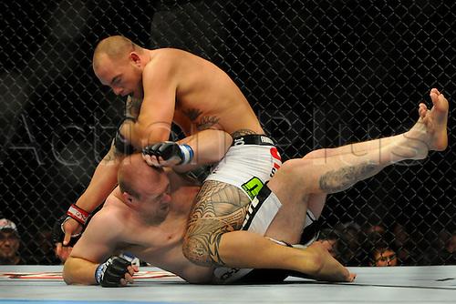 24.09.2011. Denver, Colorado. Travis Browne lands an elbow on Rob Broughton during UFC 135 at the Pepsi Center in Denver, Colorado.