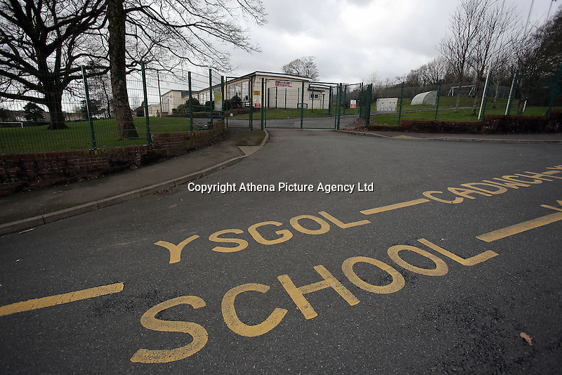 """Pictured: The bilingual """"School Keep Clear"""" sign on the tarmac outside Llangennech Junior School, west Wales. Thursday 24 February 2017<br />Re: Plans to convert Llangennech Junior School, a bilingual school to one teaching only welsh, has caused a bitter row between campaigners and politicians in Carmarthenshire, Wales, UK."""