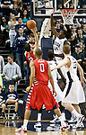 January 21, 2012:   Nevada Wolf Pack forward Dario Hunt blocks the shot of  Fresno State Bulldogs Steven Shepp during their NCAA basketball game played at Lawlor Events Center on Saturday night in Reno, Nevada.