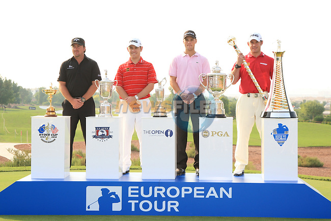 European Tour CEO George O'Grady, and 2010 Major Winners Graeme McDowell, Louis Oosthuizen, Martin Kaymer and Lee Westwood with there respective major trophys on Practice day one of the Dubai World Championship at the Earth Course, Jumeirah golf estates, Dubai, U.A.E. 23/11/2010.Picture Fran Caffrey/www.golffile.ie.