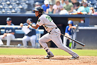 Augusta GreenJackets shortstop Manuel Geraldo (26) swings at a pitch during a game against the Asheville Tourists at McCormick Field on August 19, 2018 in Asheville, North Carolina. The Tourists defeated the GreenJackets 6-3. (Tony Farlow/Four Seam Images)
