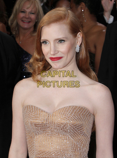 Jessica Chastain (wearing Armani Prive).85th Annual Academy Awards held at the Dolby Theatre at Hollywood & Highland Center, Hollywood, California, USA..February 24th, 2013.oscars half length blush strapless dress gown sweetheart neckline gold sparkly  headshot portrait red lipstick.CAP/ADM/SLP/COL.©Colin/StarlitePics/AdMedia/Capital Pictures