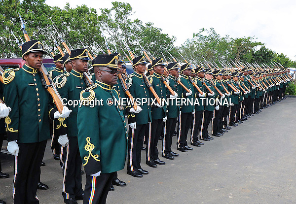 Qunu, South Africa: 14.12.2013: NELSON MANDELA BODY RETURNS TO QUNU<br /> The Presidential Guard line the route as the body of the former President Mandela returns home.<br /> The former President of South Africa Nelson Mandela will be buried in a private ceremony on Sunday 15th December 2013 in Qunu.<br /> Mandatory Credit Photo: &copy;Jiyane-GCIS/NEWSPIX INTERNATIONAL<br /> <br /> **ALL FEES PAYABLE TO: &quot;NEWSPIX INTERNATIONAL&quot;**<br /> <br /> IMMEDIATE CONFIRMATION OF USAGE REQUIRED:<br /> Newspix International, 31 Chinnery Hill, Bishop's Stortford, ENGLAND CM23 3PS<br /> Tel:+441279 324672  ; Fax: +441279656877<br /> Mobile:  07775681153<br /> e-mail: info@newspixinternational.co.uk