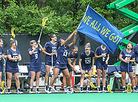 College Park, MD - May 19, 2018: Navy Morgan Bolden (17) waves a flag after Navy  scored a goal during the quarterfinal game between Navy and Maryland at  Field Hockey and Lacrosse Complex in College Park, MD.  (Photo by Elliott Brown/Media Images International)