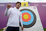 LONDON, ENGLAND - JULY 27:  Im Dong Hyun of Korea celebrates breaking the World Record during the Men's Individual Archery Ranking Round on Olympics Opening Day as part of the London 2012 Olympic Games at the Lord's Cricket Ground on July 27, 2012 in London, England. (Photo by Donald Miralle)