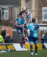 Calum Dyson of Grimsby Town is sandwiched between Will De Havilland & Michael Harriman of Wycombe Wanderers during the Sky Bet League 2 match between Grimsby Town and Wycombe Wanderers at Blundell Park, Cleethorpes, England on 4 March 2017. Photo by Andy Rowland / PRiME Media Images.