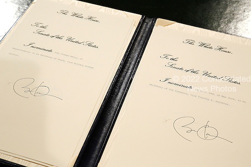 Nominations for United States Senator John Kerry (Democrat of Massachusetts) to be named U.S. Secretary of State, left, and for White House Chief of Staff Jacob Lew to be named U.S. Secretary of the Treasury, right, bear U.S. President Barack Obama's signature directly after swearing-in ceremonies in the U.S Capitol in Washington, January 21, 2013. Obama also signed nominations for former U.S. Senator Chuck Hagel (Republican of Nebraska) to be Secretary of Defense and John Brennan to be Director of the Central Intelligence Agency (CIA). .Credit: Jonathan Ernst / Pool via CNP
