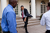 United States President Barack Obama practices his pitching form with personal aide Reggie Love and Jake Levine in the Rose Garden of the White House, Wednesday, March 31, 2010. Later that day, the President threw out the first pitch on opening day of the baseball season prior to the game between the Washington Nationals and the Philadelphia Phillies. .Mandatory Credit: Pete Souza - White House via CNP