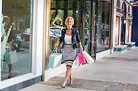 Happy female shopper walking and shopping at an Outdoor Mall in Austin, Texas.