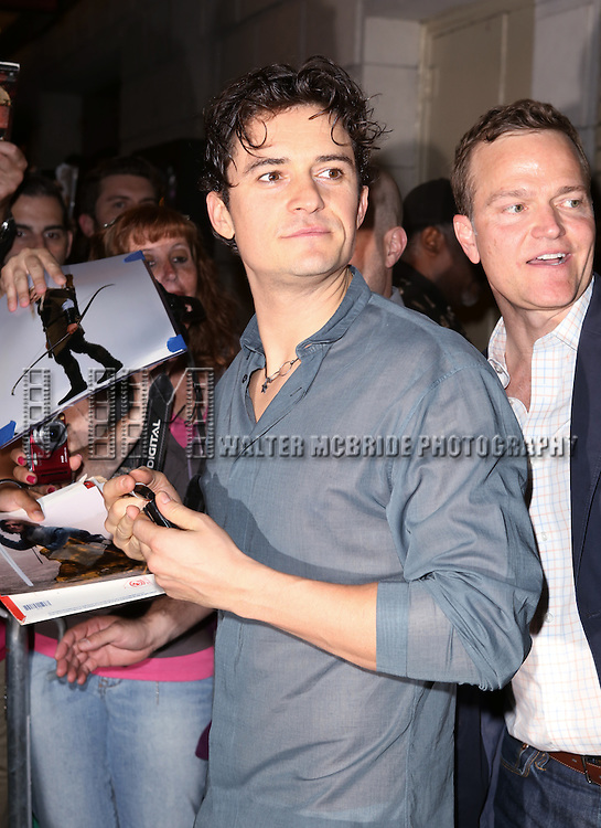 "Orlando Bloom greeting fans with Press Agent Michael Hartman at the stage door after the First Performance of ""Romeo And Juliet"" On Broadway at the Richard Rodgers Theatre in New York City on 8/24/2013"