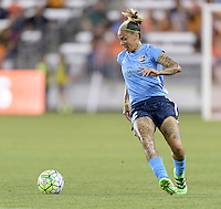 Houston, TX - Friday April 29, 2016: Tasha Kai (32) of Sky Blue FC gains control of a loose ball against the Houston Dash at BBVA Compass Stadium. The Houston Dash tied Sky Blue FC 0-0.