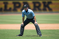 Umpire Ben Phillips handles the calls on the bases during the Carolina League game between the Salem Red Sox and the Winston-Salem Dash at BB&T Ballpark on July 23, 2017 in Winston-Salem, North Carolina.  The Dash defeated the Red Sox 11-10 in 11 innings.  (Brian Westerholt/Four Seam Images)