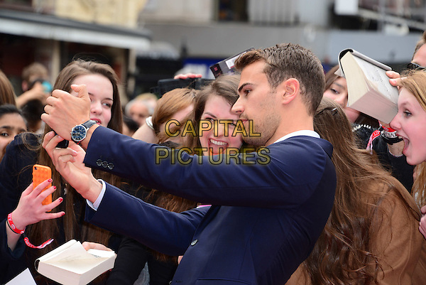LONDON, ENGLAND - MARCH 30:  Theo James attends Divergent UK film premiere, a thriller set in a futuristic dystopia that divides people based on their human traits, at Odeon Leicester Square, 24-26 Leicester Square, on March 30, 2014, in London, England.  <br /> CAP/JOR<br /> &copy;Nils Jorgensen/Capital Pictures