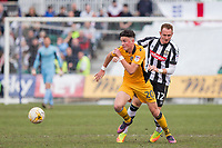 Tom Owen-Evans of Newport County gets away from Robert Milsom of Notts County during the Sky Bet League 2 match between Newport County and Notts County at Rodney Parade, Newport, Wales on 6 May 2017. Photo by Mark  Hawkins / PRiME Media Images.