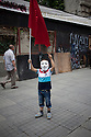 ISTANBUL, TURKEY-- JUNE 2, 2013-- A boy wearing the Guy Fawkes mask waves a Turkish flag on Sunday in central Istanbul. PHOTO BY JODI HILTON