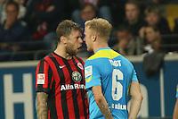 Marco Russ (Eintracht) und Kevin Vogt (Koeln) tauschen Nettigkeiten aus - Eintracht Frankfurt vs. 1. FC Köln Commerzbank Arena