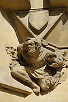 Carving of monk on exterior wall of Westminster Abbey deanery, London, England