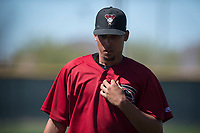 Arizona Diamondbacks relief pitcher Jhoan Duran (36) walks off the field between innings of a Spring Training game against Meiji University at Salt River Fields at Talking Stick on March 12, 2018 in Scottsdale, Arizona. (Zachary Lucy/Four Seam Images)