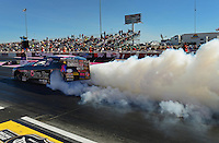 Oct. 27, 2012; Las Vegas, NV, USA: NHRA pro mod driver Leah Pruett does a burnout during qualifying for the Big O Tires Nationals at The Strip in Las Vegas. Mandatory Credit: Mark J. Rebilas-