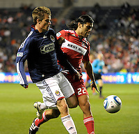 Chivas forward Justin Braun (17) battles for the ball with Chicago defender Wilman Conde (22).  The Chicago Fire tied Chivas USA 1-1 at Toyota Park in Bridgeview, IL on May 1, 2010.