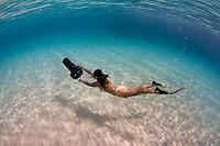 Snorkeler glides over sandy bottom with underwater scooter, Bonaire, Netherland Antilles, Caribbean Sea, Atlantic Ocean, MR