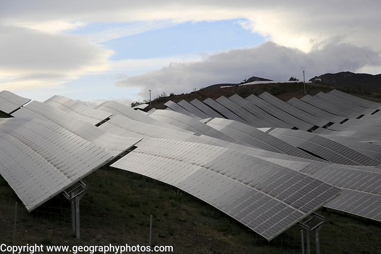 Array of solar panels on a grey overcast day, Sierra Alhamilla, near Nijar, Almeria, Spain