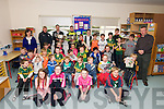Scoil Mhaolcheadair pupils and teachers welcoming Kerry players Marc Ó Sé and Brian Rael (minors) bringing Sam Maguire and Tom Markham cups to the school on Wednesday.