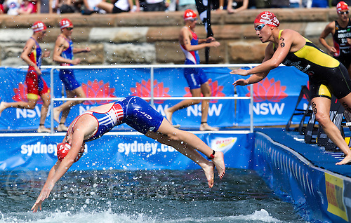 10 APR 2011 - SYDNEY, AUS - Jessica Harrison dives back in the water at the start of her second swim lap during the women's ITU World Championship Series triathlon in Sydney, Australia .(PHOTO (C) NIGEL FARROW)