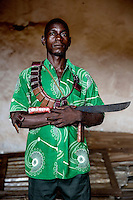 A member of a Muslim 'self-defence' group holds a machete and is draped with 'Gris Gris' amulets that confer good fortune and protection on their wearers. They are animist in origin but also worn by both Muslims and Christians throughout west and central Africa. In late 2012 after years of instability and conflict, the Seleka, a predominantly Muslim rebel group, fuelled by grievances against the government, overran the country and, In March 2013, ousted President Francois Bozize, who fled the country. The rebel's leader Michel Djotodia was proclaimed president in August 2013. He disbanded the Seleka in September 2013 but law and order collapsed and ex-Seleka fighters roamed the country committing atrocities against the civilian population. In an attempt to defend their lives and property vigilante groups, calling themselves Anti-Balaka (Anti-Machete), formed to confront the ex-Seleka fighters but soon began to take reprisals against the wider Muslim population and the conflict became increasingly sectarian. By December 2013, with international fears of a genocide being voiced, French led peacekeepers deployed to the country began to act on a UN mandate to disarm the fighters and protect the civilian population. However, they have struggled to contain the situation. Much of the Muslim population, in particular, have been forced into ghettos where they are suffering from food shortages and limited access to healthcare. Often, only a few peacekeepers stand between them and a massacre by vengeful Anti-Balaka militants. UN reports describe 'thousands' killed, while over 600,000 people have been internally displaced and a further 200,000 have fled the county.