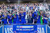 Cardiff City captain Sean Morrison lifts a trophy with manager Neil Warnock as they celebrate promotion after the Sky Bet Championship match between Cardiff City and Reading at the Cardiff City Stadium, Cardiff, Wales on 6 May 2018. Photo by Mark  Hawkins / PRiME Media Images.